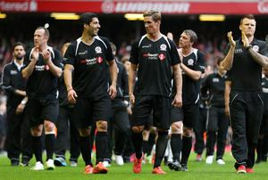 Football - Steven Gerrard All-Stars v Jamie Carragher All-Stars - Liverpool FC Foundation Charity Match - Anfield - 29/3/15 Luis Suarez and Fernando Torres at the end of the match Action Images via Reuters / Alex Morton Livepic EDITORIAL USE ONLY.