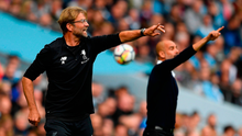 Jurgen Klopp (left) and Pep Guardiola will both have one eye on Tuesday's Champions League second-leg tie during today's games. Photo: Stu Forster/Getty Images