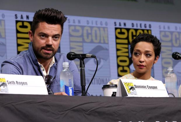 """Dominic Cooper (L) and Ruth Negga speak onstage during the """"Preacher"""" Hall H panel at San Diego Comic-Con International 2017 at the San Diego Convention Center on July 21, 2017 in San Diego, California.  (Photo by Jesse Grant/Getty Images for AMC)"""