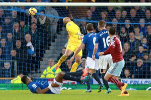 Everton goalkeeper Tim Howard (centre) watches the ball fly into his net as West Ham United's Mauro Zarate (right) scores. Photo credit: Peter Byrne/PA Wire