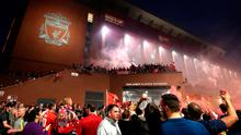 Liverpool fans celebrate outside Anfield after the Reds were crowned Premier League champions this evening after Manchester City lost 2-1 to Chelsea at Stamford Bridge.