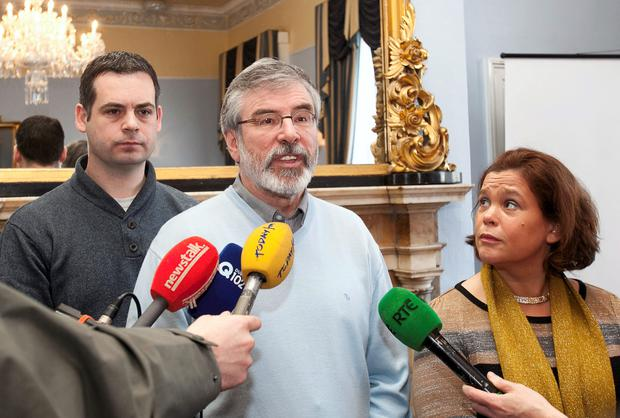 Gerry Adams (centre) has been forced to defend himself over inappropriate remarks about guns in light of the murders of Independent group journalists Veronica Guerin and Martin O'Hagan.