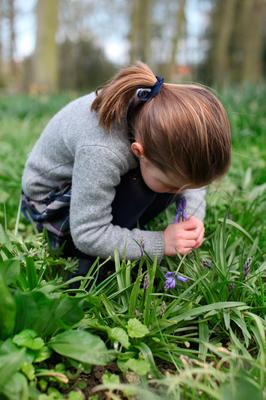 Undated handout photo taken by the Duchess of Cambridge of Princess Charlotte smelling a bluebell at their home in Norfolk in Spring 2019, which was referred to by the Duchess in the 'Happy Mum, Happy Baby' podcast with Giovanna Fletcher