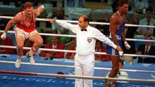 FAMOUS DAY: Michael Carruth had to beat Billy Walsh in a box-off to make the 1992 Olympics, where he would claim welterweight gold after beating Cuba's Juan Hernández Sierra (right) in the final in Barcelona.