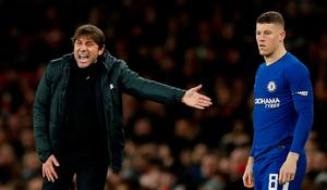 Chelsea's Ross Barkley waits to come on as a substitute as manager Antonio Conte looks on