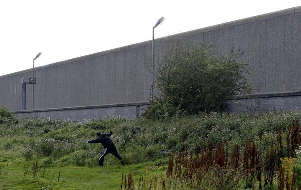 Drugs being thrown over the perimeter wall of Wheatfield Prison, from adjacent waste ground.