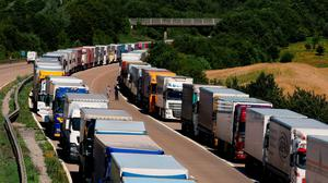 Lorries parked on the M20 near Charing in Kent as freight transport chiefs have said that Britain's freight industry is losing ?750,000 a day because of the huge problems lorry drivers have faced this summer trying to cross the Channel. PRESS ASSOCIATION Photo. Issue date: Friday July 24, 2015. The migrant crisis in Calais, wildcat strike action by ferry workers and protesting farmers mean truckers are spending hours stuck in queues in Kent and northern France. See PA story POLICE Eurotunnel. Photo credit should read: Gareth Fuller/PA Wire