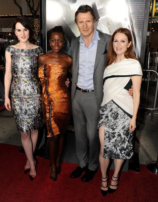 """WESTWOOD, CA - FEBRUARY 24:  (L-R) Actors Michelle Dockery, Lupita Nyong'o, Liam Neeson and Julianne Moore attend the premiere of Universal Pictures and Studiocanal's """"Non-Stop"""" at Regency Village Theatre on February 24, 2014 in Westwood, California.  (Photo by Kevin Winter/Getty Images)"""