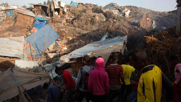 People look at the damage done to dwellings built near the main landfill of Addis Ababa on the outskirts of the city on March 12, 2017 (Image: Getty Images)