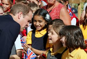 Britain's Prince William speaks with school children as he officially opens the Dickson Poon University of Oxford China Centre, in Oxford