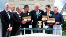 Matthieu Baumgartner (left) presents Jockey Ryan Moore (right), Trainer A P O'Brien (second right), owner John Magnier (third right) and winning connections of Arizona with the trophy after winning the Coventry Stakes during day one of Royal Ascot at Ascot Racecourse. Photo: Adam Davy/PA Wire.