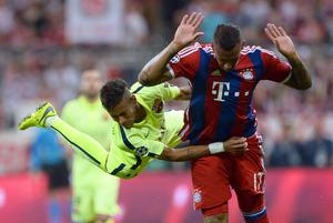 Barcelona star Neymar gets to grips with Bayern Munich's Jerome Boateng during last night's Champions League semi-final, second leg