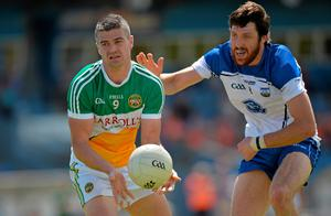 Offaly's Niall Smith in action against Waterford's Tommy Prendergast yesterday. Photo: Matt Browne
