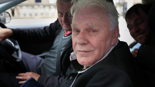 Freddie Starr leaves the High Court in London at the start of a slander and libel claim against a woman who says he groped her when she was in the audience at a Jimmy Savile show when she was a 15-year-old. PRESS ASSOCIATION Photo. Picture date: Monday June 15, 2015. The 72-year-old entertainer was at London's High Court in a wheelchair to face his accuser, Karin Ward, at the start of a two-week slander and libel trial before Mr Justice Nicol. He told the judge, who is hearing the case without a jury, that he did not at first remember appearing on Clunk Click in March 1974 - 41years ago - until footage showed him in the studio, with Ms Ward in the audience behind him. See PA story COURTS Starr. Photo credit should read: Jonathan Brady/PA Wire