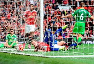Wayne Rooney bundles the ball over the line for Manchester United's second goal yesterday
