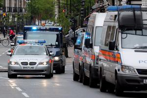 A police van carrying Michael Adebowale arrives at Westminster Magistrates Court in London