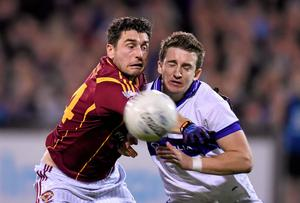 Bernard Brogan of St Oliver Plunketts Eogha Ruadh grapples with Jarlath Curley of St Vincent's during the Dublin SFC final at Parnell Park. Photo: Stephen McCarthy / SPORTSFILE