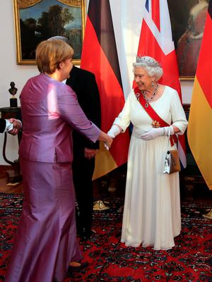 In a speech at a state banquet, attended by Prime Minister David Cameron and German Chancellor Angela Merkel, pictured, the queen emphasised Britain's 'key part' in shaping the continent