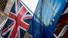 European (right) and Union flags are displayed outside Europe House, the European Parliament's British offices, in London. PRESS ASSOCIATION Photo. Picture date: Tuesday June 21, 2016. Photo credit should read: Lauren Hurley/PA Wire