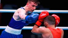 Ireland's Brendan Irvine (blue) defeats Hungary's Istvan Szaka (red) during day three of the Boxing Road to Tokyo 2020 Olympic qualifying event at the Copper Box Arena, London.