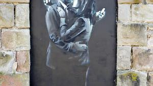 File photo dated 15/04/14 of a view of the latest Banksy artwork, named Mobile Lovers, as David Stinchcombe MBE, 58, a youth centre leader who removed the Banksy artwork from a wall in Clement Street, Bristol, near to the Broad Plain & Riverside Youth Project , said he has been issued with death threats over the issue. PRESS ASSOCIATION Photo. Issue date: Wednesday April 16, 2014. See PA story ARTS Banksy. Photo credit should read: Ben Birchall/PA Wire