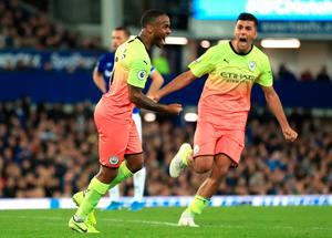 Manchester City's Raheem Sterling (centre) celebrates scoring his side's third goal of the game with team-mates during the Premier League match at Goodison Park, Liverpool.
