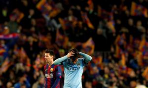 Manchester City's David Silva reacts at the end of their Champions League round of 16 second leg soccer match against Barcelona at Camp Nou stadium in Barcelona March 18, 2015.      REUTERS/Albert Gea (SPAIN  - Tags: SPORT SOCCER)