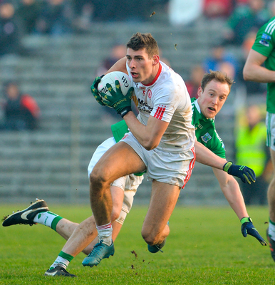 Tyrone's Padraig McNulty slips away from Fermanagh's Lee Cullen. Photo: Oliver McVeigh/Sportsfile