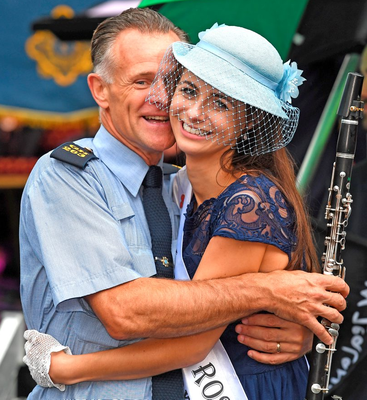 Wexford Rose Sarah-Mai Fitzpatrick gets a hug from her father Pat, who is a member of the Garda Band Photo: Domick Walsh
