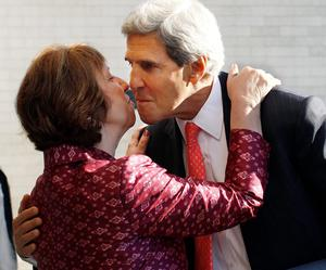 US Secretary of State John Kerry greets European Union Foreign Policy Chief Catherine Ashton after arriving for an informal meeting of EU ministers for Foreign Affairs at the National Art Gallery in Vilnius, Lithuania
