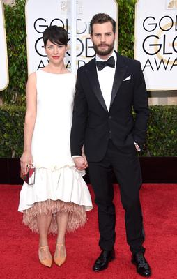 Actress Amelia Warner (L) and actor Jamie Dornan attend the 72nd Annual Golden Globe Awards at The Beverly Hilton Hotel