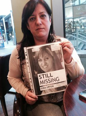 Berna Fidan with a poster of her missing sister Esra.