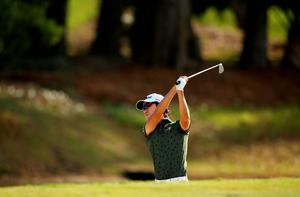 Kevin Na plays his second shot on the fifth hole during round one of THE PLAYERS Championship at the TPC Sawgrass