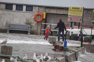 A Father with his two children have a lucky escape on the pier at Bullock harbour in south county Dublin during yesterdays storm and high tides, despite the recent warnings from the coast guards & emergency services. The young children were knocked over by a wave and were extremely lucky not to have been washed into the harbour.