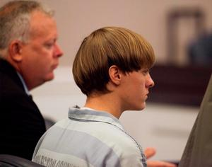 Dylann Roof (right) in court, charged with nine murders (Reuters)