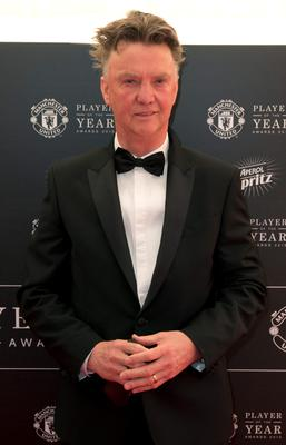 Manchester United's Dutch manager Louis van Gaal poses for pictures on the red carpet as he arrives to attend the 'Manchester United Player of the Year Awards' at Old Trafford stadium in Manchester, northern England, on May 19, 2015. AFP PHOTO / OLI SCARFFOLI SCARFF/AFP/Getty Images