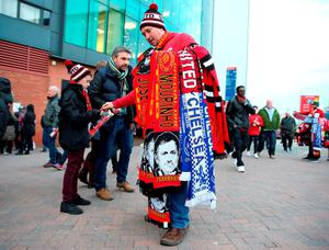 Jose Mourinho scarves on sale outside Old Trafford. Photo: Martin Rickett/PA Wire