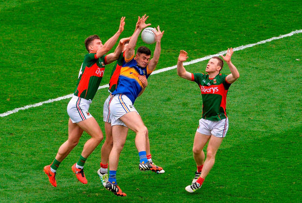 Tipperary's Michael Quinlivan under pressure from Barry Moran, Lee Keegan and Colm Boyle in Croke Park yesterday. Photo: Sportsfile