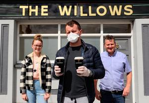 Albert Martin (right), owner of The Willows pub in Glasnevin, with his son Albert (centre) and daughter Joanne as the family run pub has started up a delivery service  Photo credit: Brian Lawless/PA Wire