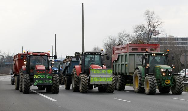 French farmers drive their tractors on the A7 highway to protest changes in underprivileged farm area's mapping and against Mercosur talks, in PIerre-Benite near Lyon, France, February 21, 2018.  REUTERS/Emmanuel Foudrot
