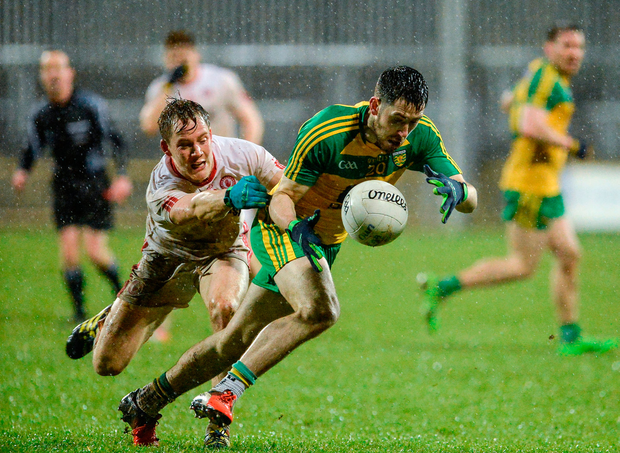 Mark McHugh of Donegal in action against Kieran McGeary of Tyrone. Photo by Oliver McVeigh/Sportsfile