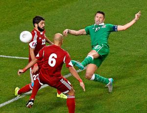 Robbie Keane is at full stretch as he fires an effort on the Georgia goal a during last night's Euro 2016 qualifier