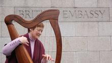 Gone: Cork harpist Ruth Mc Donnell played 'The Parting of Companions'  – 'Scaruint na gCompanach' outside the British Embassy in Dublin to mark Brexit Day. Picture: John Mc Elroy