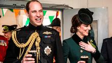 Britain's Prince William and Catherine, the Duchess of Cambridge, stand with pints of Guinness in their hands as they visit soldiers of the 1st battalion Irish Guards in their canteen following their St Patrick's Day parade at Cavalry Barracks, Hounslow on Friday, 17th March 2017REUTERS/Richard Pohle/Pool