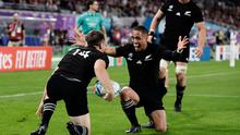 New Zealand's Ben Smith is congratulated by teammates after scoring a try