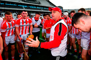 Imokilly manager Fergal Condon speaks to his team after their win. Photo: Ramsey Cardy/Sportsfile