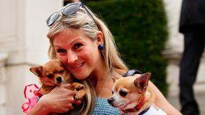 Reality TV star Nikki Grahame, with her dogs Baby and Thumbelina. Photo: Yui Mok/PA Wire
