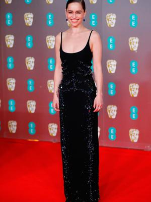 British actress Emilia Clarke poses on the red carpet upon arrival at the BAFTA British Academy Film Awards at the Royal Albert Hall in London on February 2, 2020. (Photo by Tolga AKMEN / AFP)