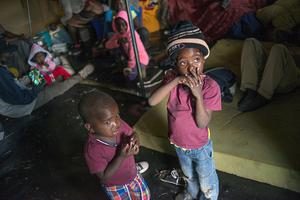 Children stand inside a tent for Foreign nationals refugees in Primrose, a little village near Johannesburg, on April 18, following a wave of xenophobic violence against immigrants and other foreigners (Getty Images)