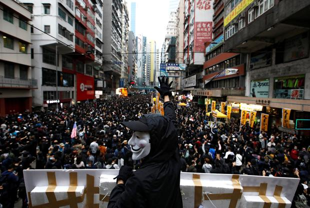 An anti-government protester wearing a Guy Fawkes mask takes part in a demonstration during New Year's Day to call for better governance and democratic reforms in Hong Kong. Photo: Reuters/Navesh Chitrakar